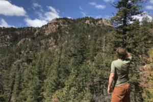 Benjamyn Looking Up At Mountains